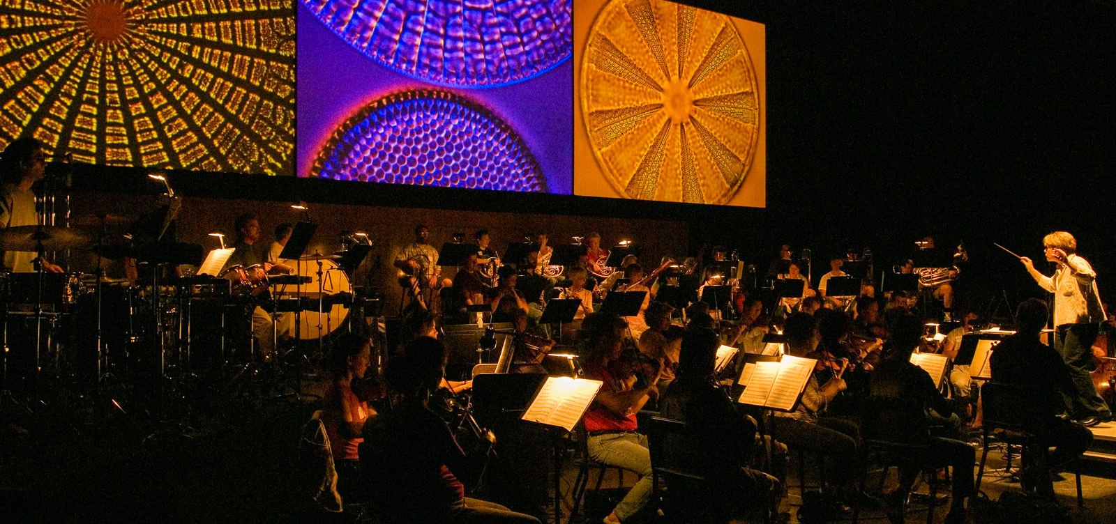 Marin Alsop conducting the multimedia performance of Frans Lanting's LiIFE; A Journey Through Time, Cabrillo Music Festival, Santa Cruz, California