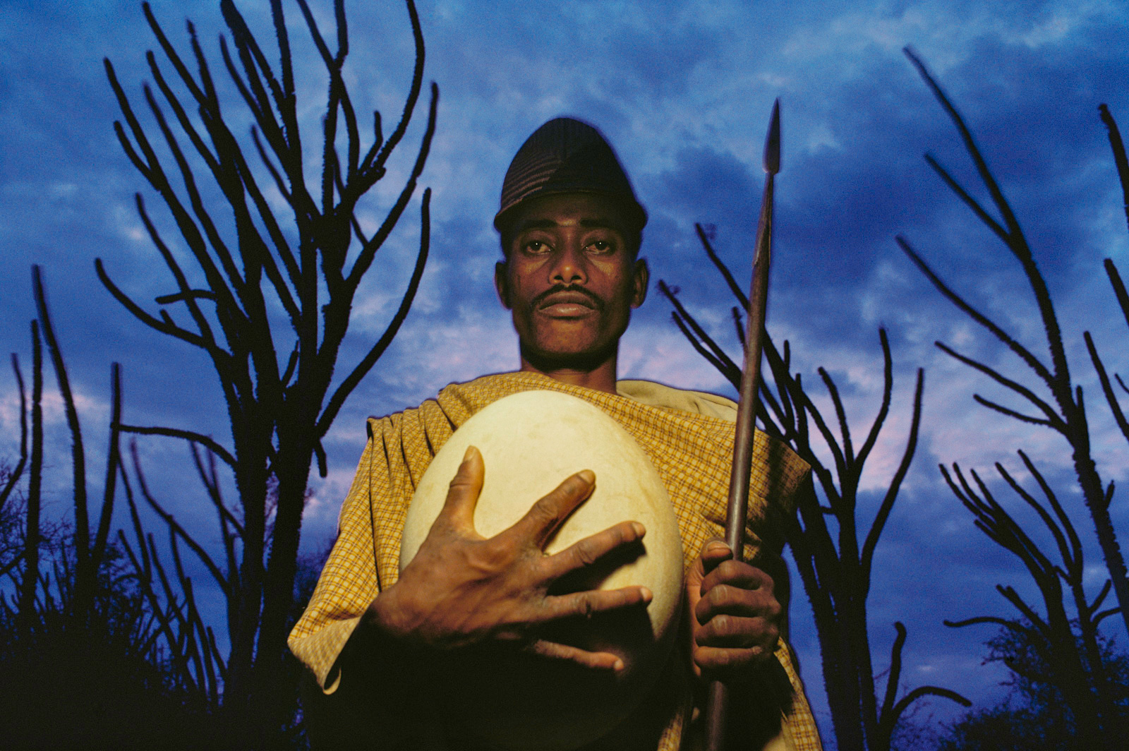 Antandroy tribesman with fossilized elephant bird egg, Southern Madagascar