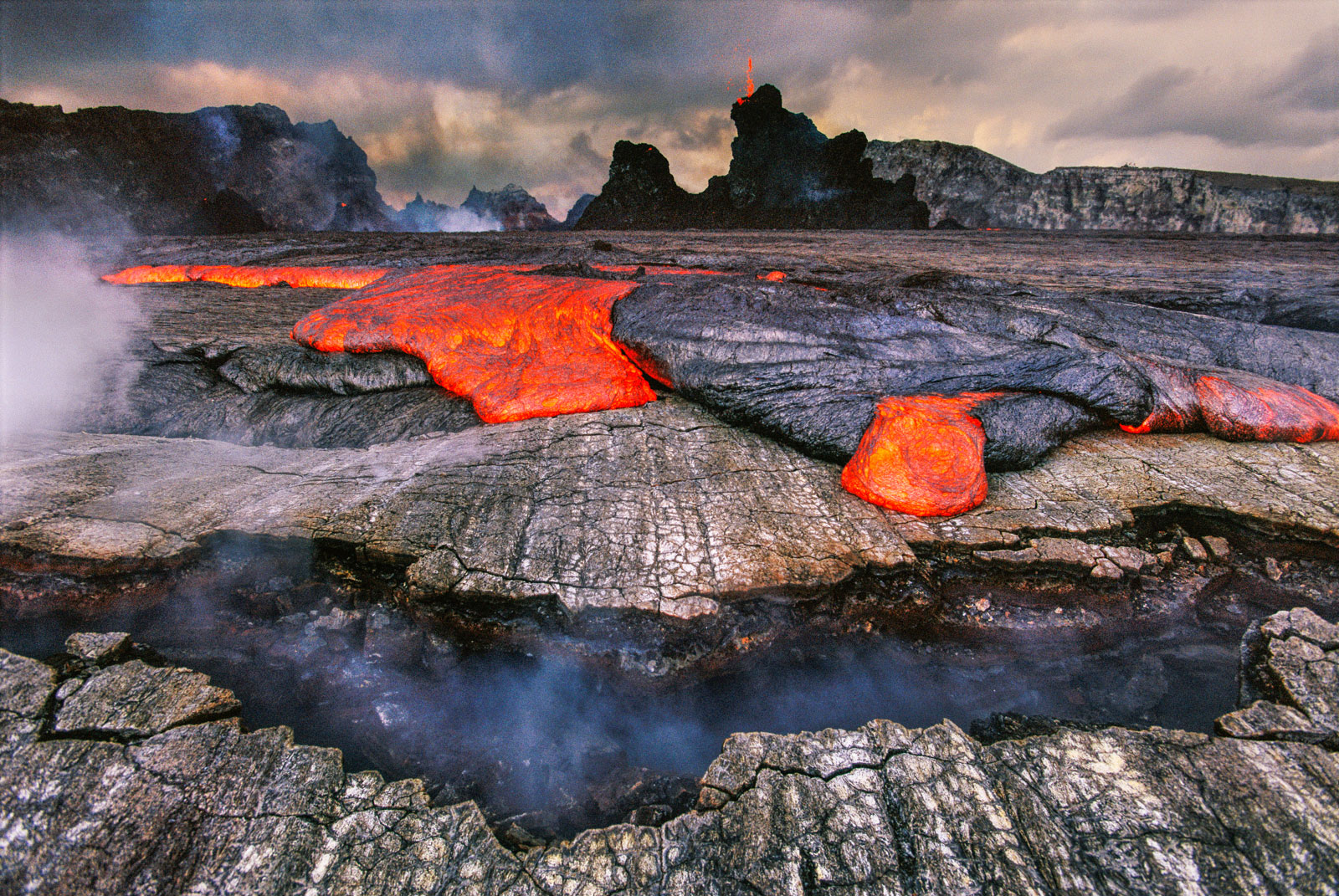 Lava overflowing caldera of Pu'u 'O'o, Hawaii Volcanoes National Park, Hawaii, USA
