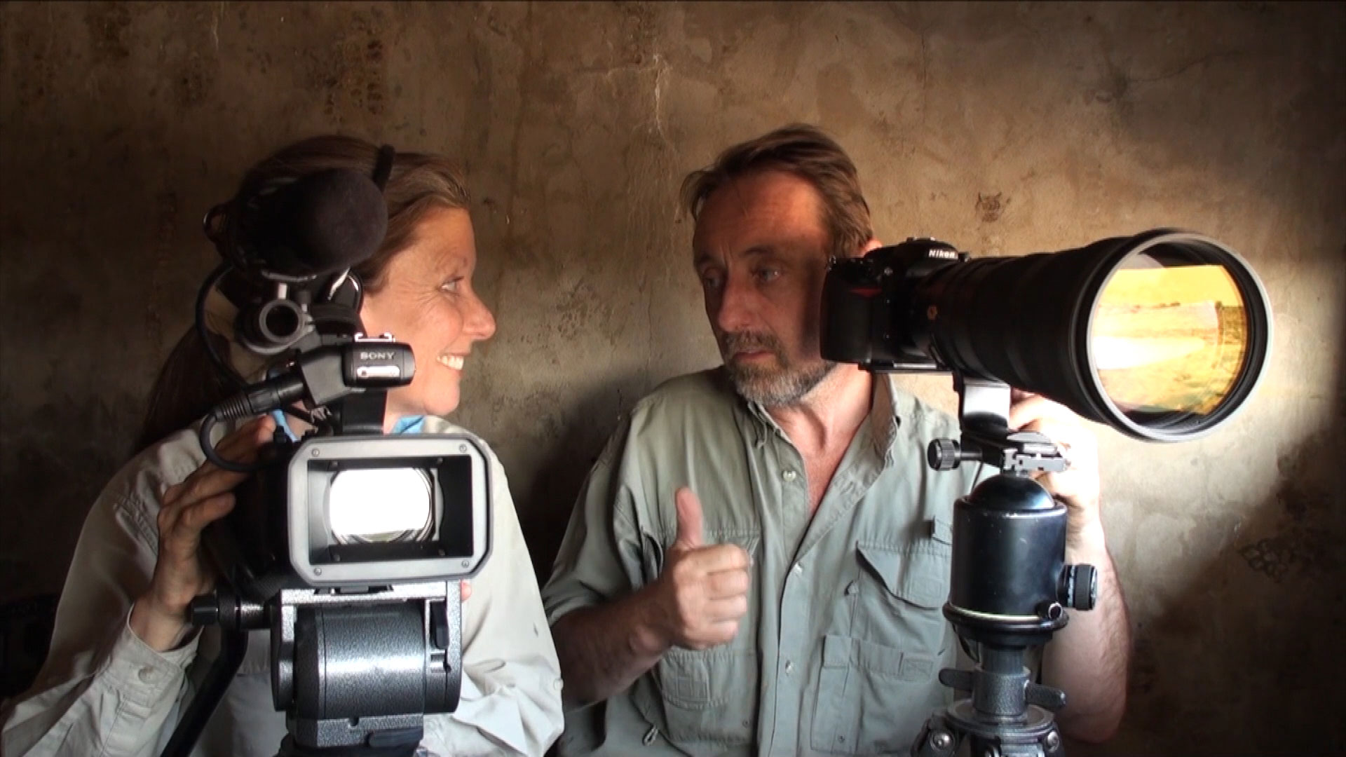 Frans Lanting and Christine Eckstrom in observation hideout, Etosha National Park, Namibia