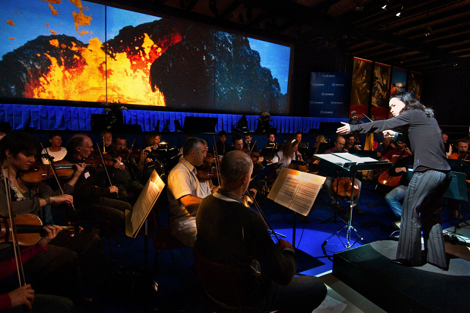 Carolyn Kuan conducting the multimedia production of Frans Lanting's Origins, Geneva, Switzerland